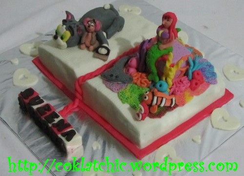 Cake buku dengan tom and jerry dan little mermaid