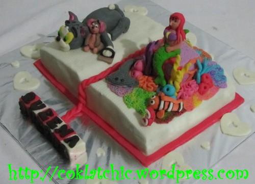 Cake buku dengan tom and jerry dan little mermaid