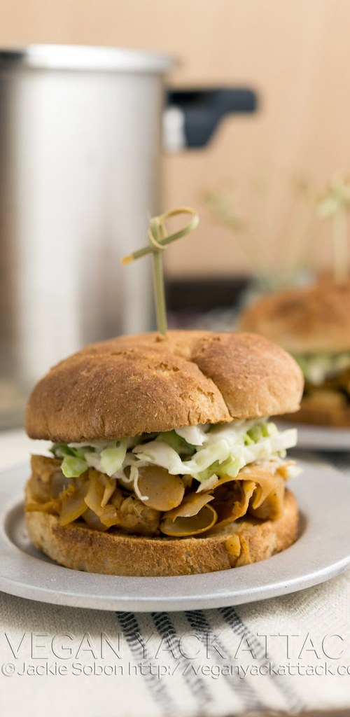 Vegan, pressure cooker pulled jackfruit that is perfectly seasoned and spicy! Great in sliders with coleslaw topping.