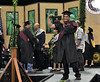 """A Hawaii Community College graduate demonstrates that knowledge is power after receiving his diploma during the commencement ceremony in Hilo on May 13, 2016.  View more photos:  Hawaii CC in Hilo Commencement Flickr albums <a href=""""https://www.flickr.com/photos/53092216@N07/albums/72157668574343065"""">www.flickr.com/photos/53092216@N07/albums/72157668574343065</a> <a href=""""https://flic.kr/s/aHskzYUgNL"""" rel=""""nofollow"""">flic.kr/s/aHskzYUgNL</a>  Hawaii CC–Palamanui Commencement Flickr Album <a href=""""https://www.flickr.com/photos/53092216@N07/albums/72157668170978492"""">www.flickr.com/photos/53092216@N07/albums/72157668170978492</a>"""