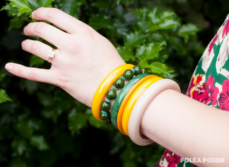 Bakelite bracelets (and one fake) add a pop of color to a vintage ensemble