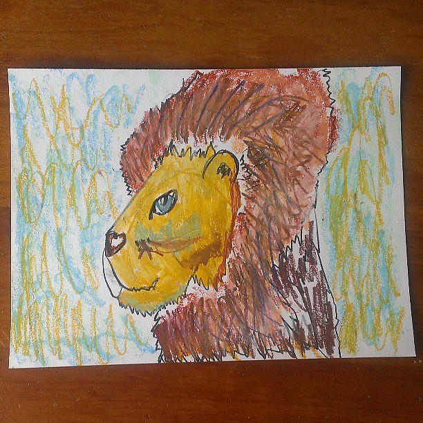 Oil pastel lion portrait by Annika (age 6)
