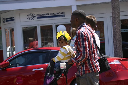 Baby dressed as flower with her dad