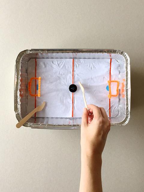 Table top ice hockey