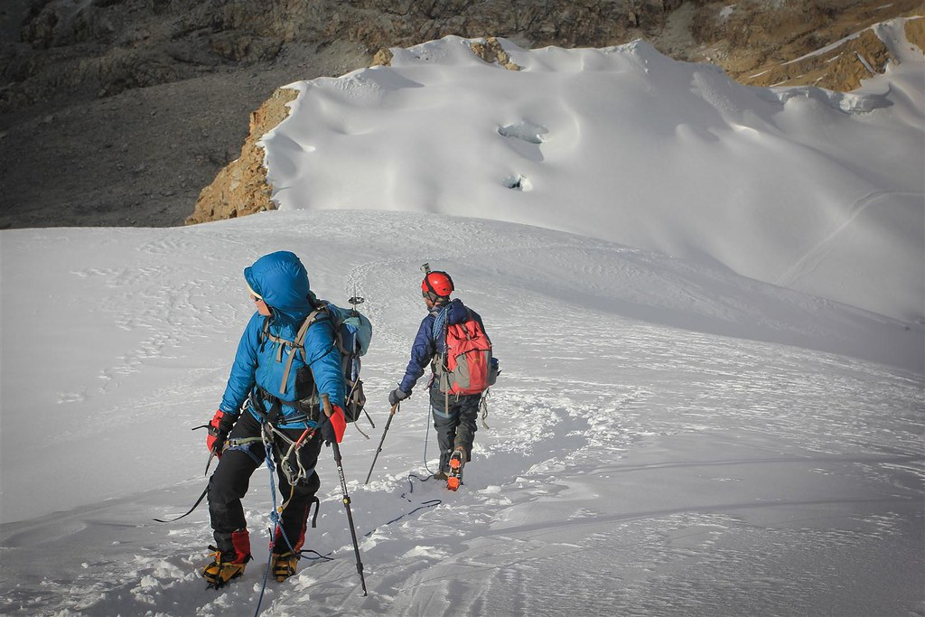 Avalanche gazing on the upper slopes of Ishinca (5530m). Cordillera Blanca. Peru.