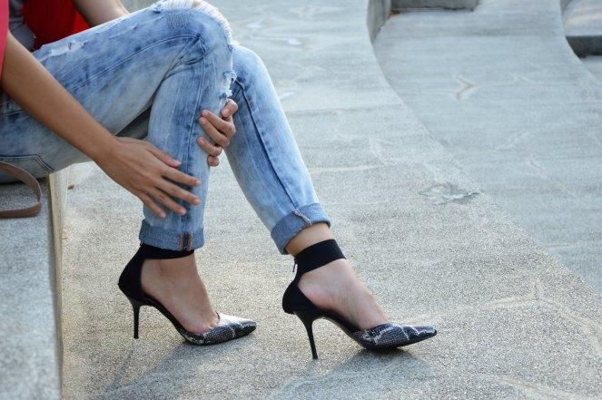 cuffed boyfriend jeans, pointed snakeskin heels