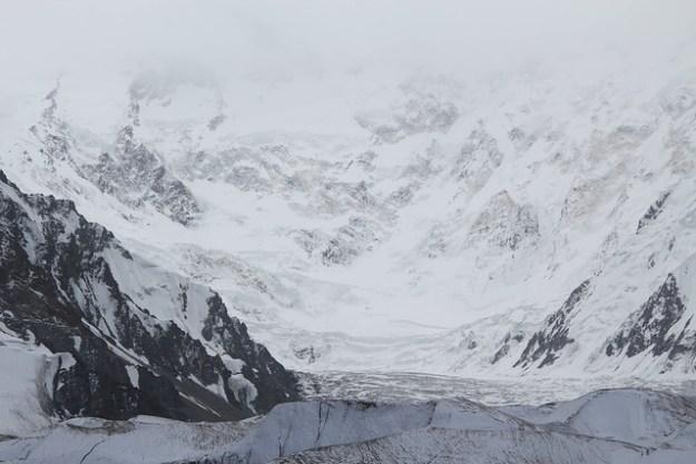 Low clouds over Peak Pobeda. South Inylchek Glacier Trek
