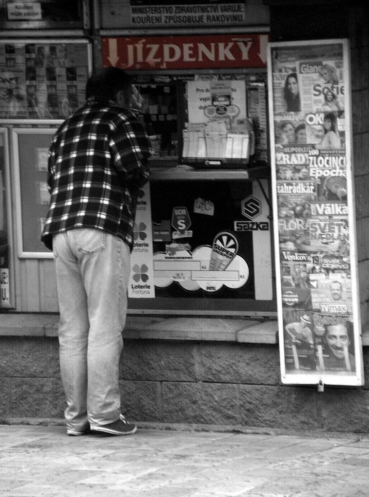 Man Buying a Ticket