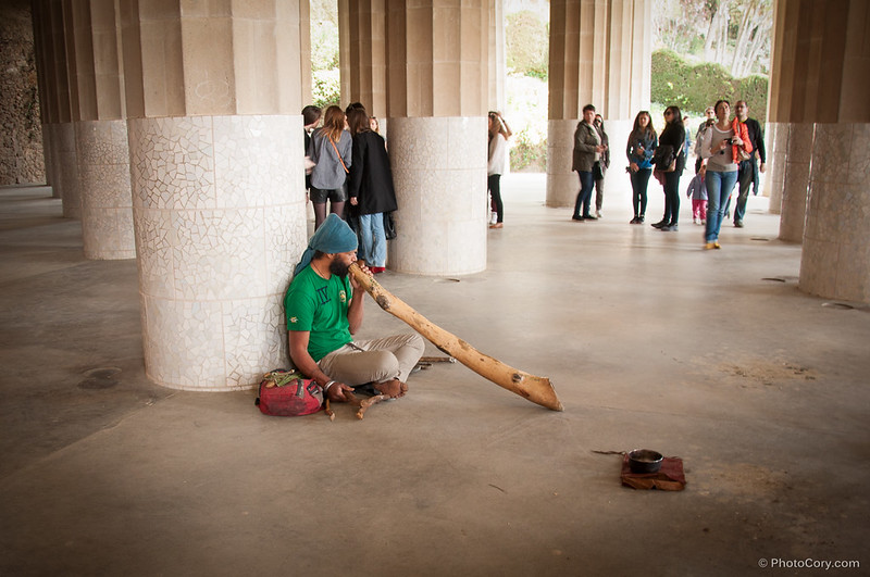man playing an instrument in Park Guell