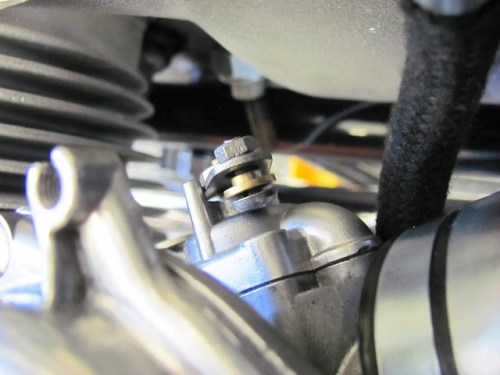 Choke Mounting Hardware on Carburetor with Hole in Shaft and Brass Retaining Ring