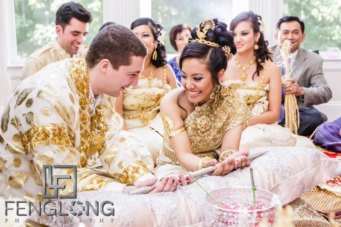 Cambodian bride and groom receive blessing during wedding