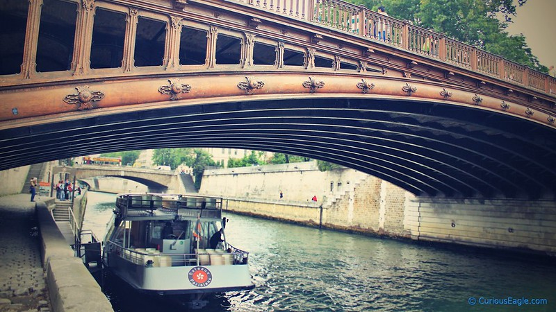 Curvy wooden bridge over Seine in Paris