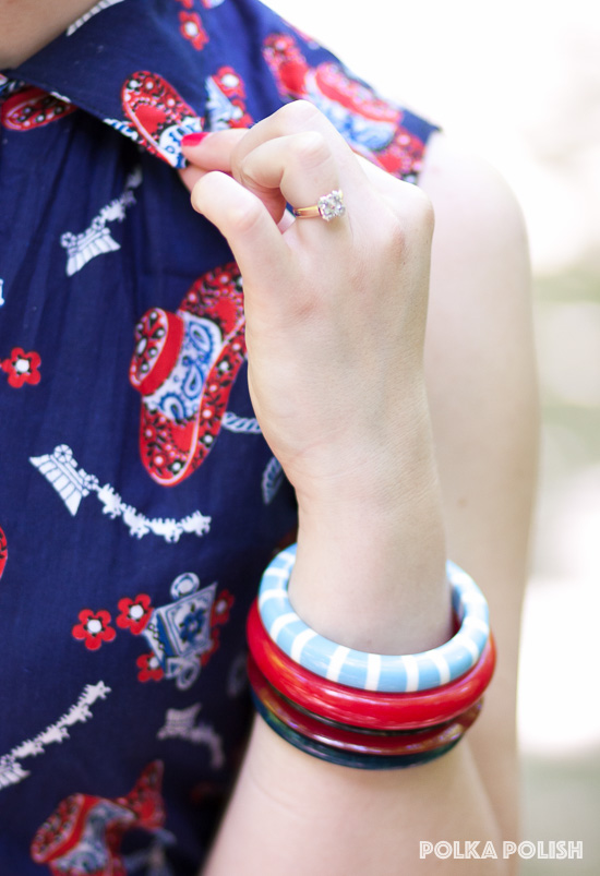 A stack of vintage bakelite and lucite bangles compliments the patriotic colors of this novelty print ensemble