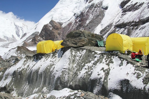 Tents on the edge of a crevasse, base camp. South Inylchek Glacier Trek