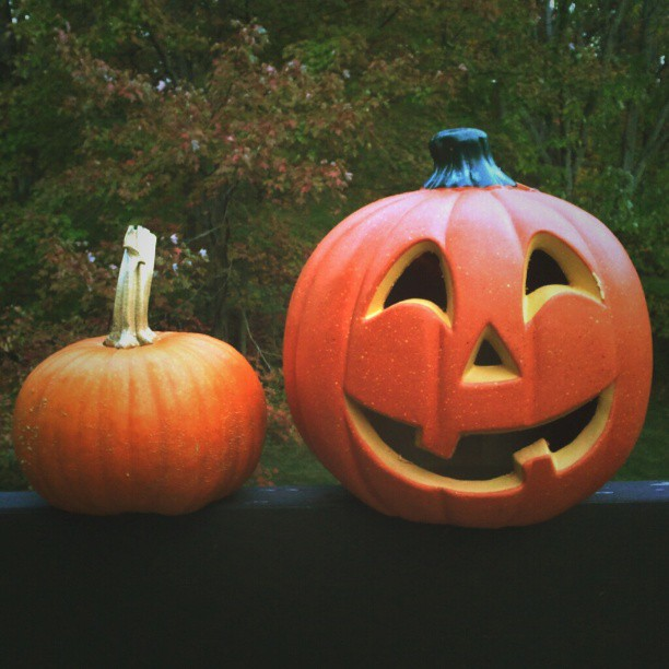 Two pumpkins sitting on a wall #pumpkin #orange #jackolantern #halloween