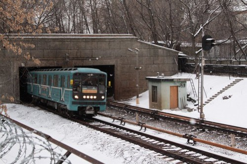 Type 81-717/714 train on the Moscow Metro returns to the surface