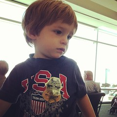 My little tsa officer- he's a travel champ.