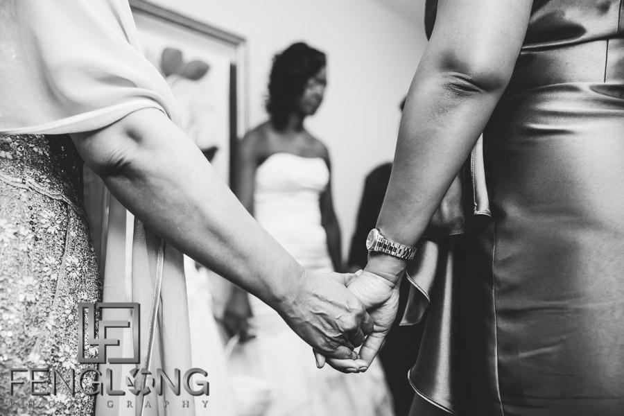 Bride prays with family before wedding ceremony