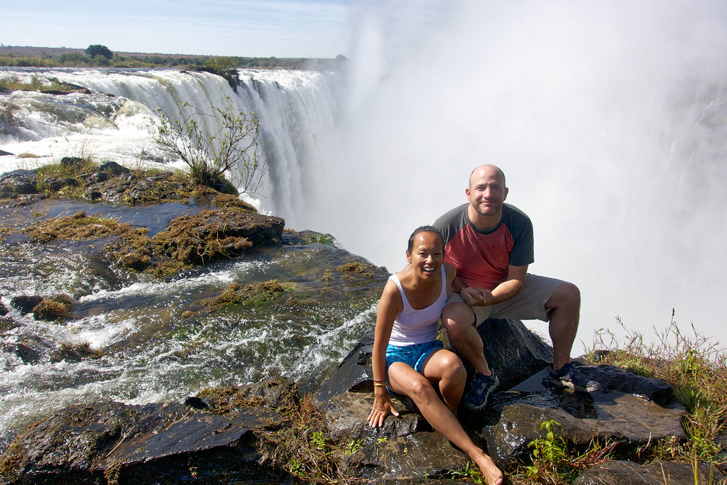 Sitting at the edge of Victoria Falls on Livingstone Island.