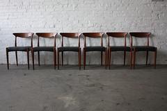 Smoldering Arne Hovmand Olsen Danish Modern Century Modern Teak Dining Chairs for Mogens Kold (Denmark, 1960's)