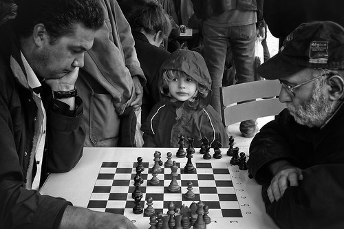 Chess players and the young girl