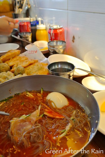 Mul-nangmyeon mixed with vinegar and mustard. Mandu in the background. Seoul South Korea Bukchon