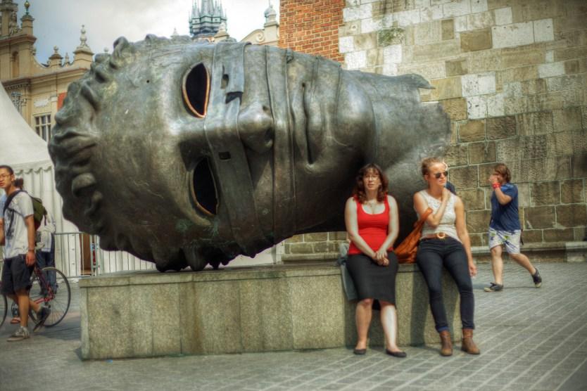 Eros Bendato (The Head) by Polish artist Igor Mitoraj, Main Square, Kraków.