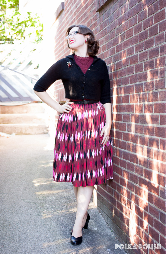 A mostly modern 1950s inspired outfit in red and black, with a harlequin skirt from Pin Up Girl Clothing and black Marilyn pumps from Royal Vintage Shoes