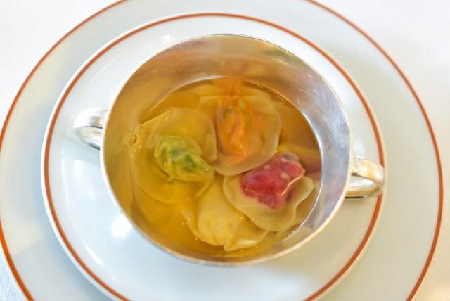 vegetable ravioli with tomato consumee