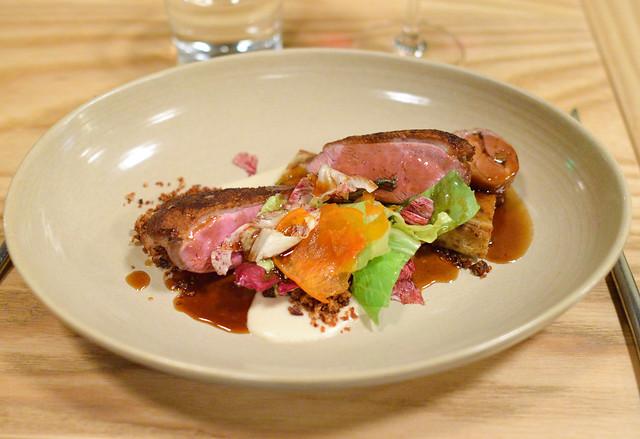 LIBERTY FARMS DUCK BREAST Duck Leg Roulade, Persimmon, Pecan Crumble, Bourbon-Maple Jus