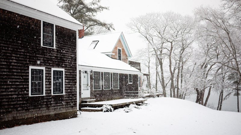 Family Maine Home Covered in Snow