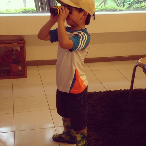 G2 all ready for exploration with a pair of Wellies and his trusty binoculars!