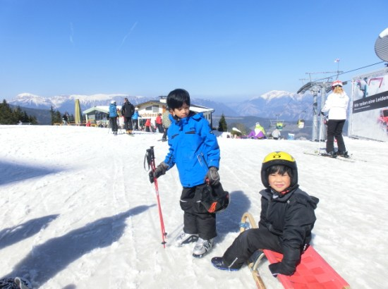 boys sled, skiing