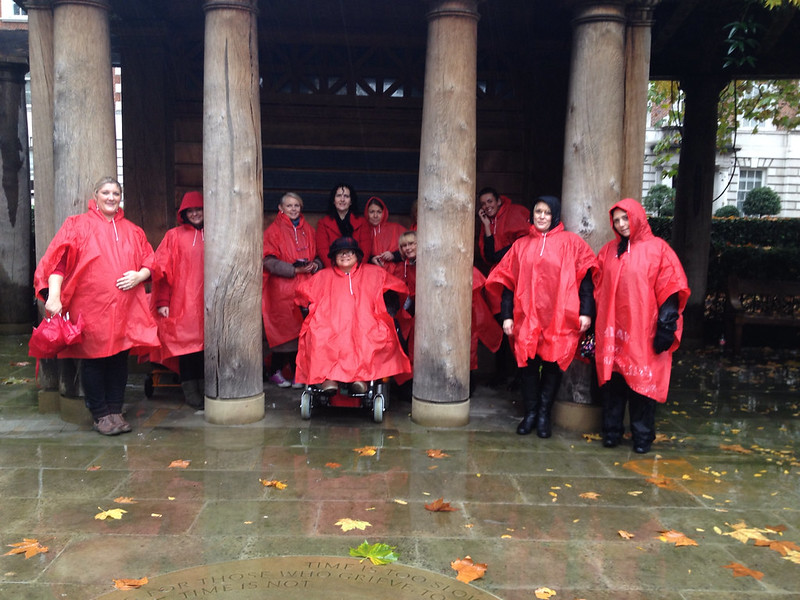 women in red ponchos in the red