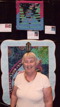 Judy and award-winning quilt