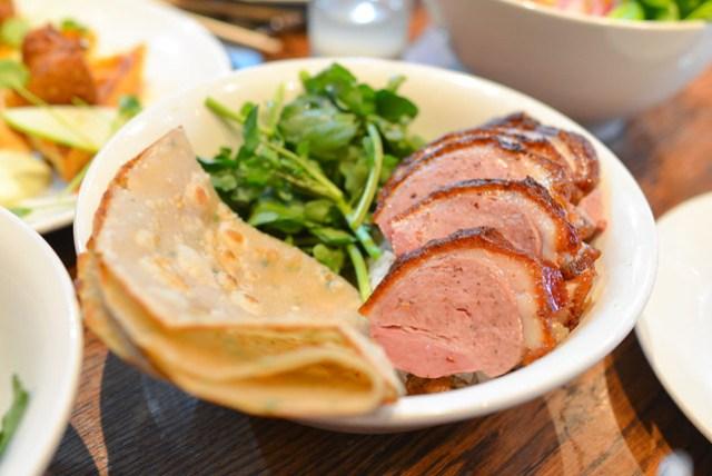 rotisserie duck over rice duck scallion, ssäm sauce, crispy shallot, chive pancake