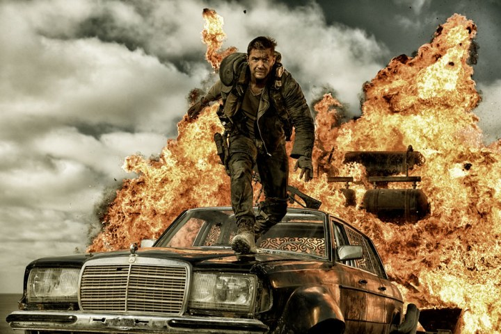 Mad Max stepping calmly away from an exploding vehicle. (Credit: Warner Bros Pictures)