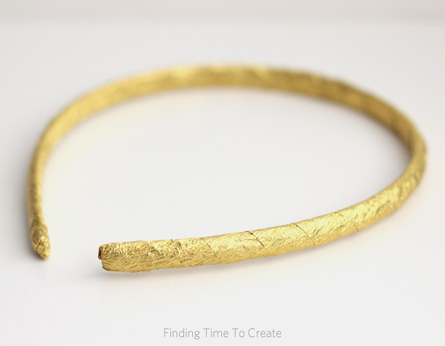 Headband wrapped with gold foil crepe paper
