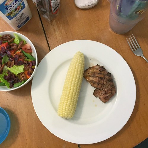 grilled chicken thighs, corn on the cob, salad