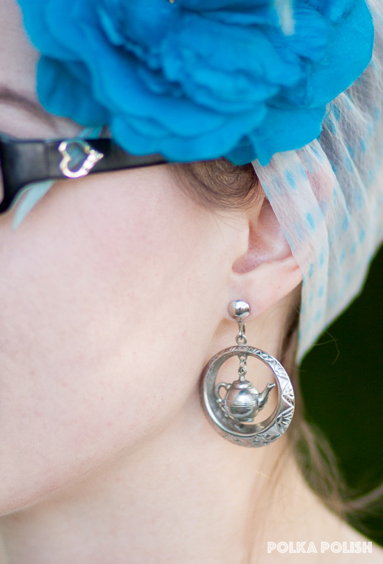 Novelty silver-tone teapot earrings add a touch of whimsy to any outfit
