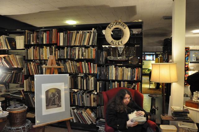 Choosing vintage postcards at Bookman's Alley