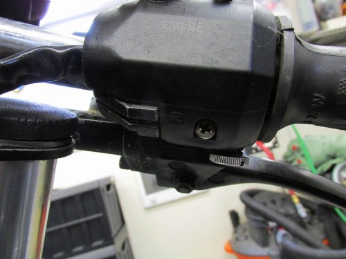 Right Handlebar Combination Switch Secured at Bottom With Phillips Head Screw