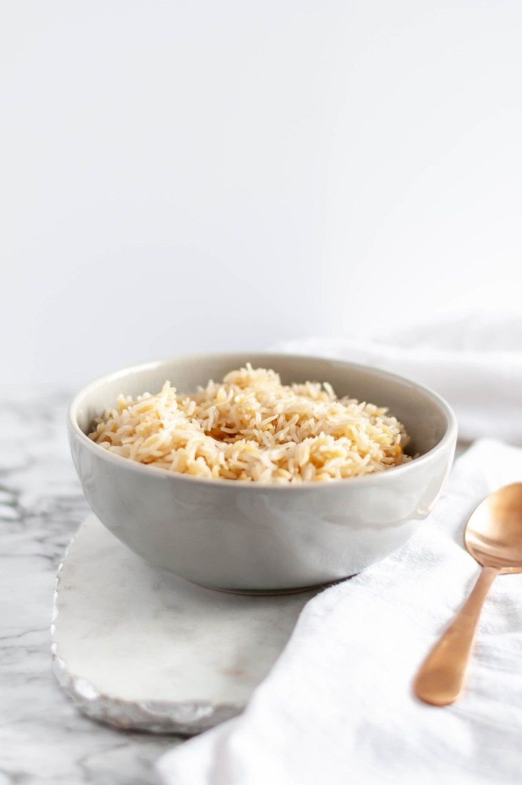 Make this Instant Pot Rice Pilaf for a super simple and flavorful side dish any night of the week. Staple pantry ingredients make up the dish and it takes less than 20 minutes to make. Perfect for a busy weeknight meal.