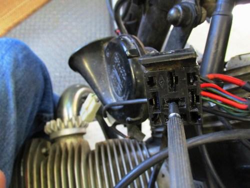 Using Jewelers Screw Driver to Flatten The Spade Terminal Retaining Pin