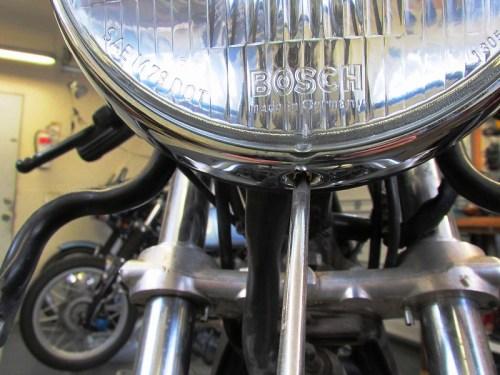 Removing Headlight Screw Securing Headlight Lens & Chrome Ring to Headlight Shell