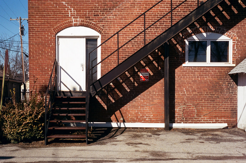Brick wall with iron stairs