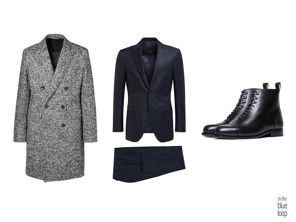 Homme au look formel avec costume bleu, manteau et bottes oxford noires