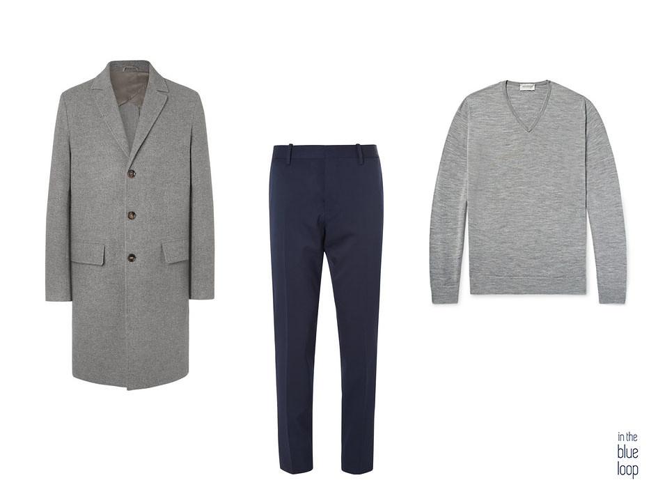Look smart-casual con abrigo gris, pantalón de vestir azul y jersey de pico