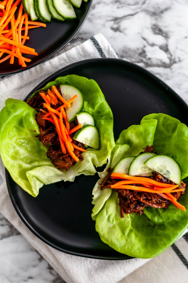 Slow Cooker Asian Beef Lettuce Wraps is the easiest kind of recipe. Everything in the slow cooker then serve in lettuce wraps with crunchy toppings.