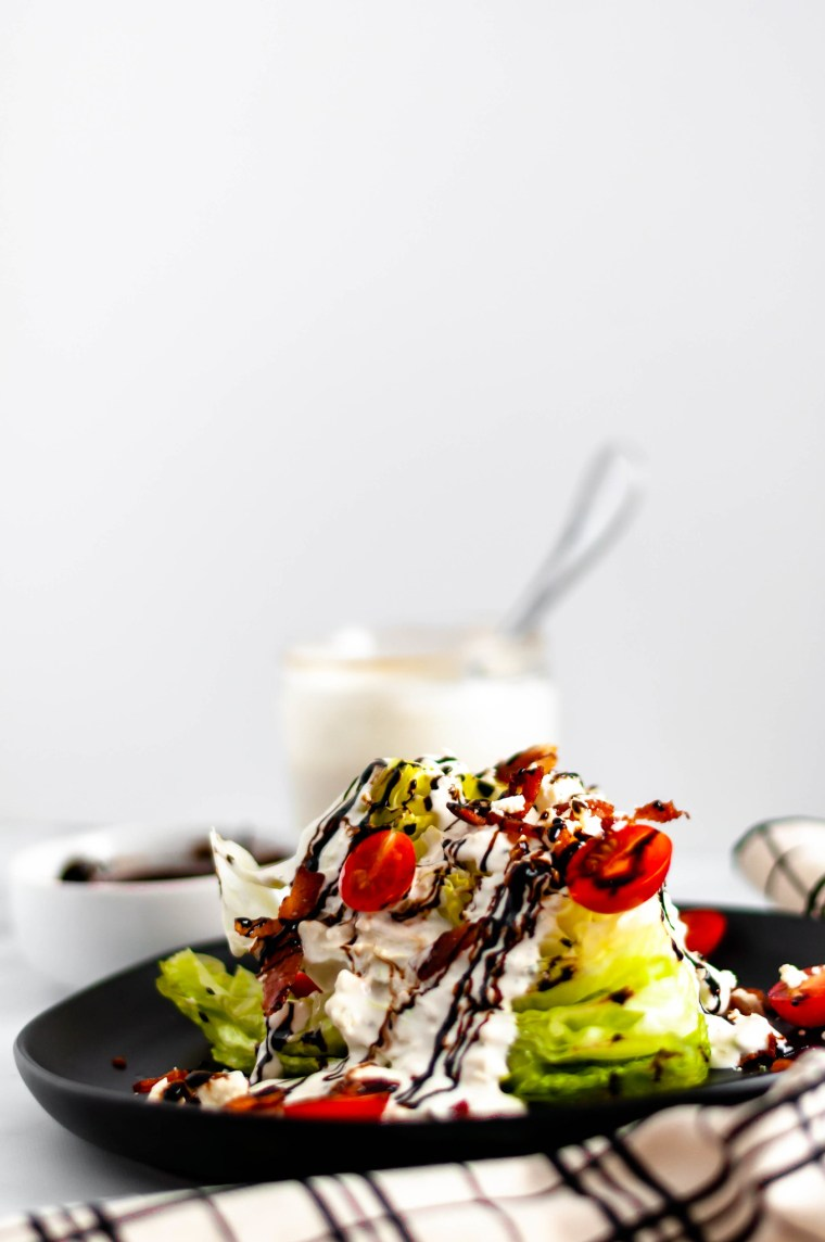 Start off any meal with this Classic Wedge Salad. Homemade blue cheese and a drizzle of balsamic glaze provide so much flavor to this classic salad.
